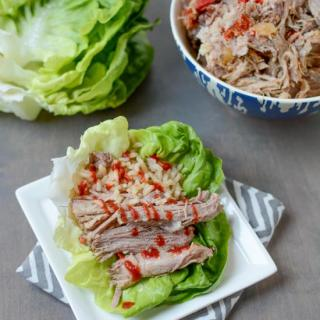 This Slow Cooker Asian Pulled Pork in lettuce wraps with rice for a quick dinner!