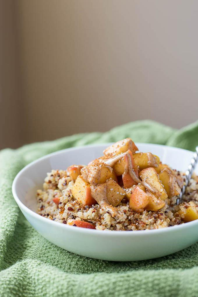 This Caramelized Peach Quinoa Breakfast Bowl is packed with protein and makes a great summer breakfast.