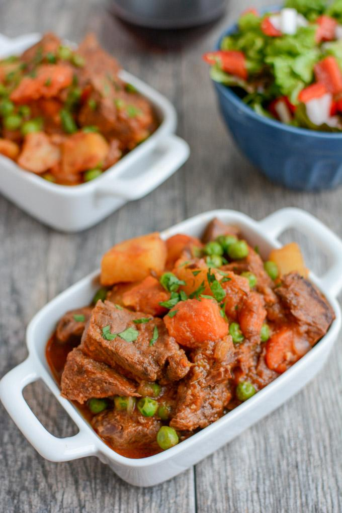 This healthy Instant Pot Beef Stew recipe is ready in under an hour and tastes like it has been simmering all day. It's paleo, gluten-free and the perfect dinner on a cold winter night.