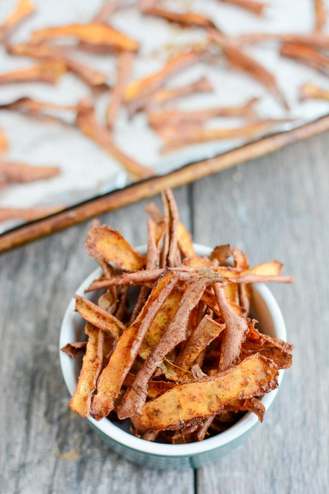 These Cinnamon Sugar Sweet Potato Peels are a fun dessert idea! Eat them as is, crumble over ice cream or yogurt or drizzle with chocolate for a sweet treat!
