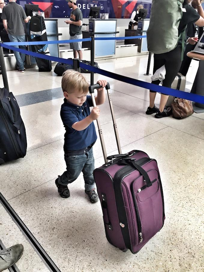 Toddler with suitcase