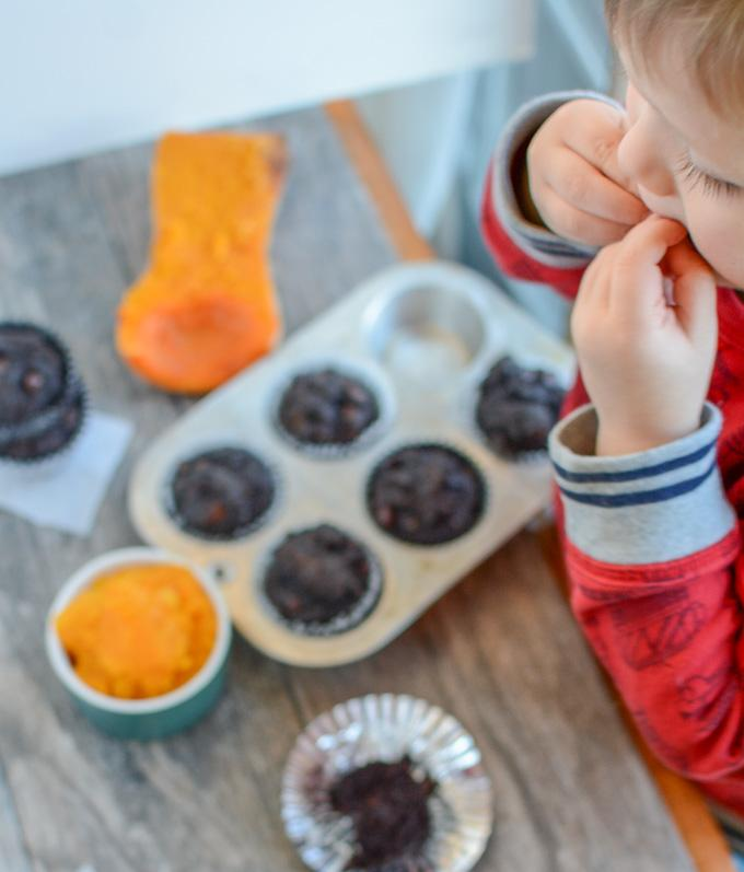 kid eating chocolate butternut squash muffin