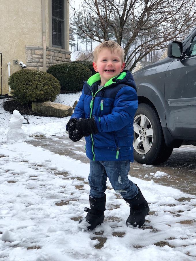 toddler throwing snow