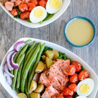 This Salmon Nicoise Salad is an easy, flavorful twist on a classic recipe. Made with roasted vegetables, baked salmon and a simple dressing, it's perfect for a healthy lunch or dinner!