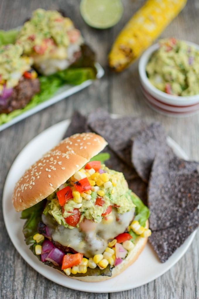 Mexican Burgers topped with grilled corn salsa, pepperjack cheese and guacamole