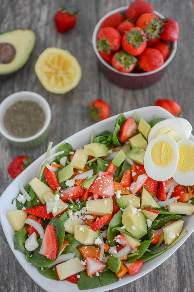 Loaded strawberry spinach salad with hard boiled eggs