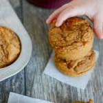 toddler hand grabbing carrot applesauce muffin