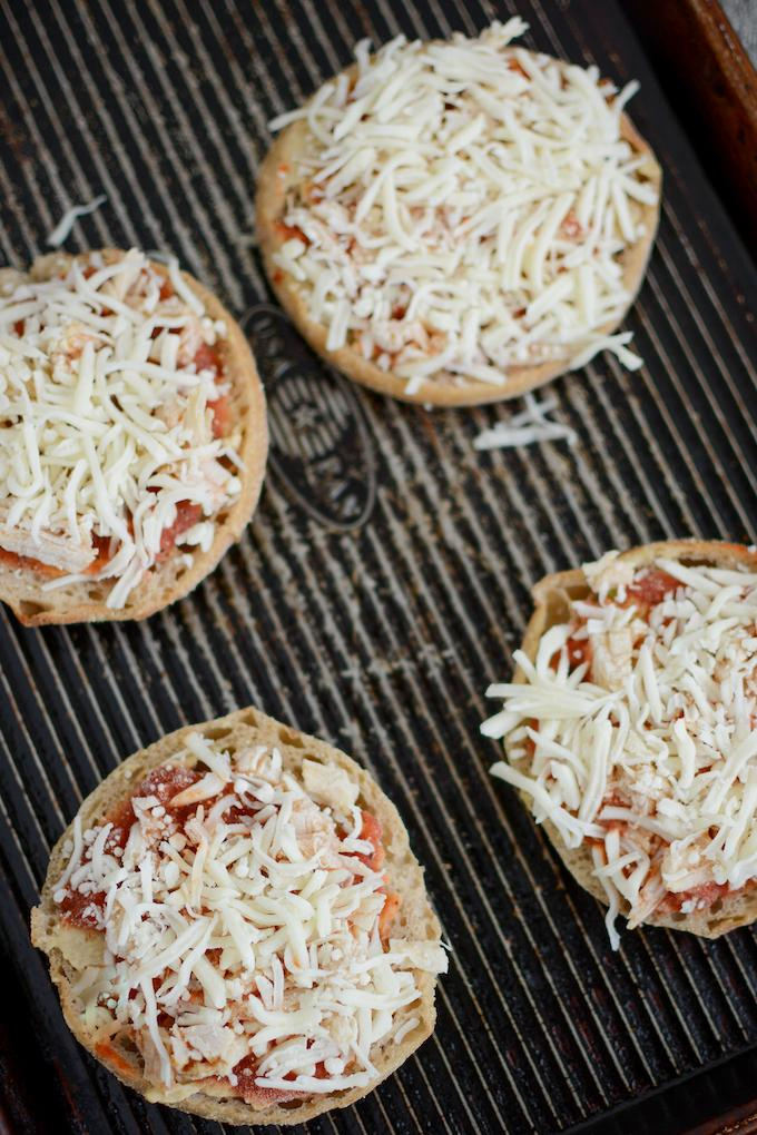 frozen english muffin pizzas on a tray