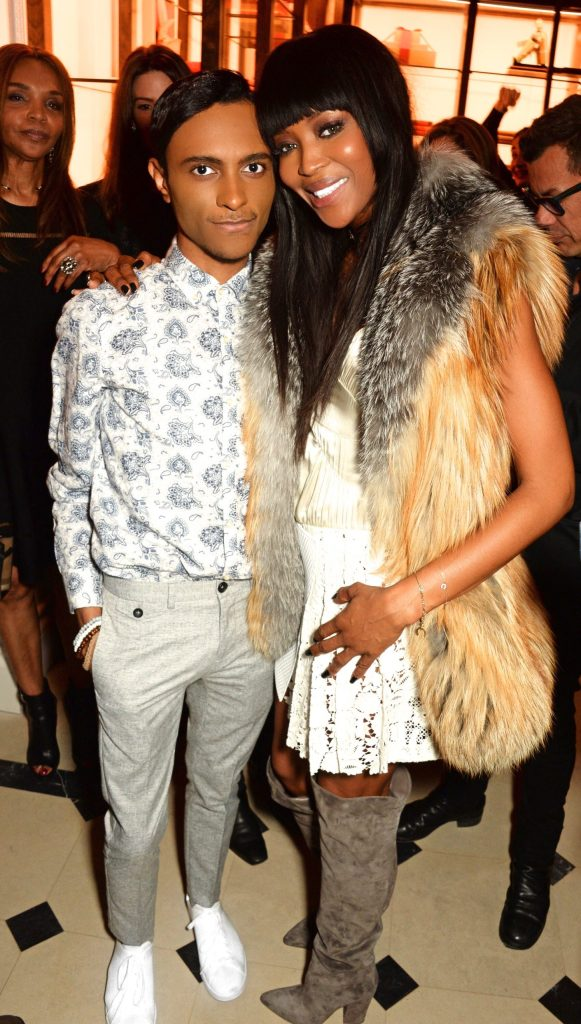 Naomi Campbell approached Hayden Williams to share one of his drawings of her in a book project she had been working on. She poses with him in this picture at the launch of her book which contains his illustration.