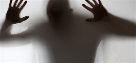 shadowy-figure-trapped-behind-glass-m-466