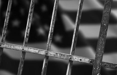 american-flag-behind-bars-466