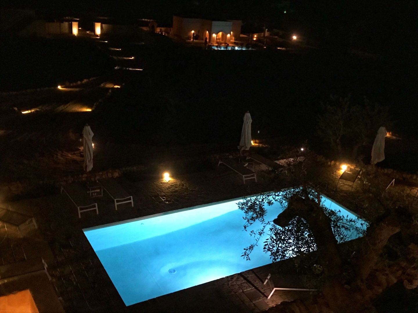 Corte dei Massapi villa pool view at night