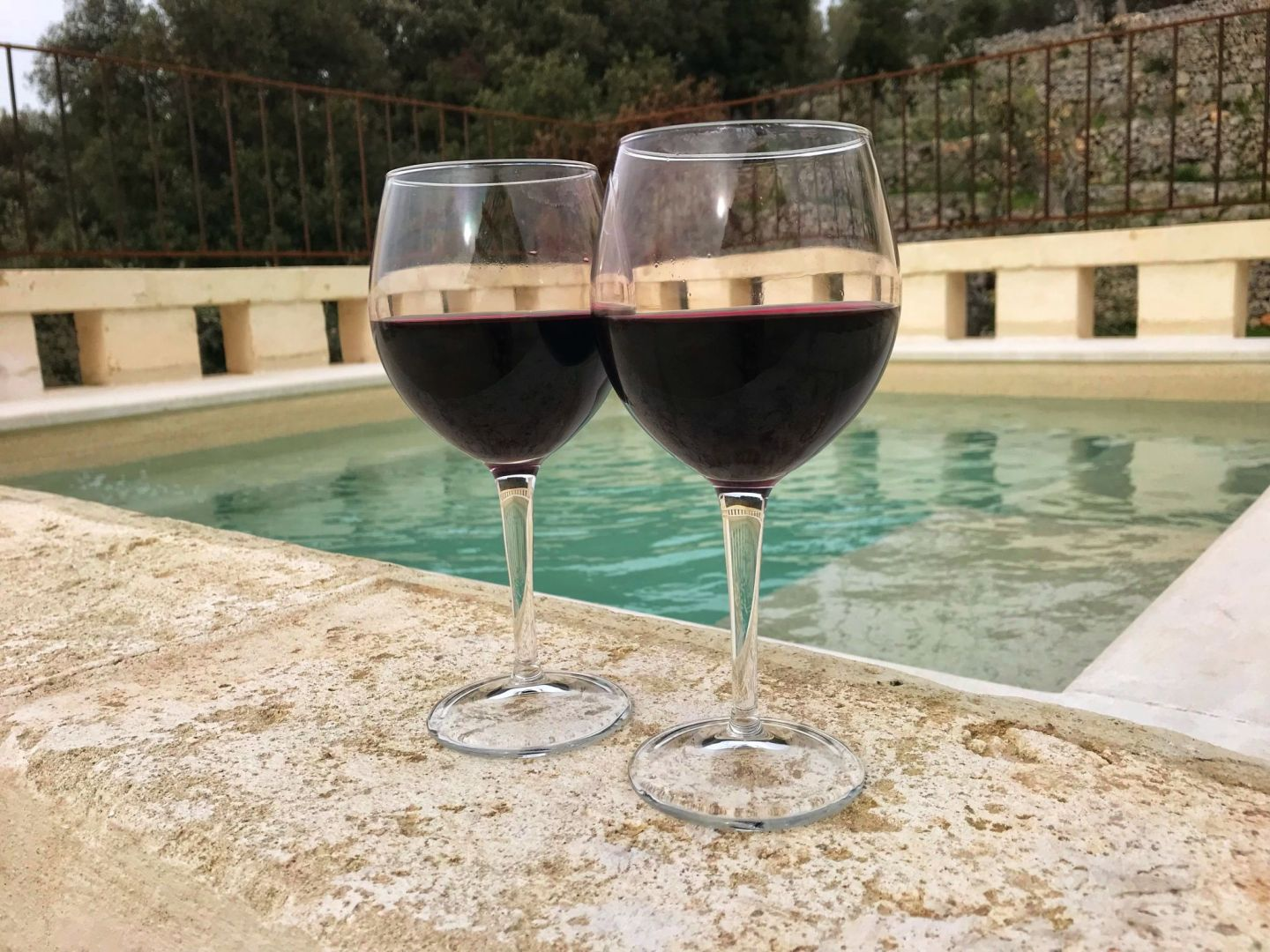 Red wine by the hot tub at Corte dei Massapi villa