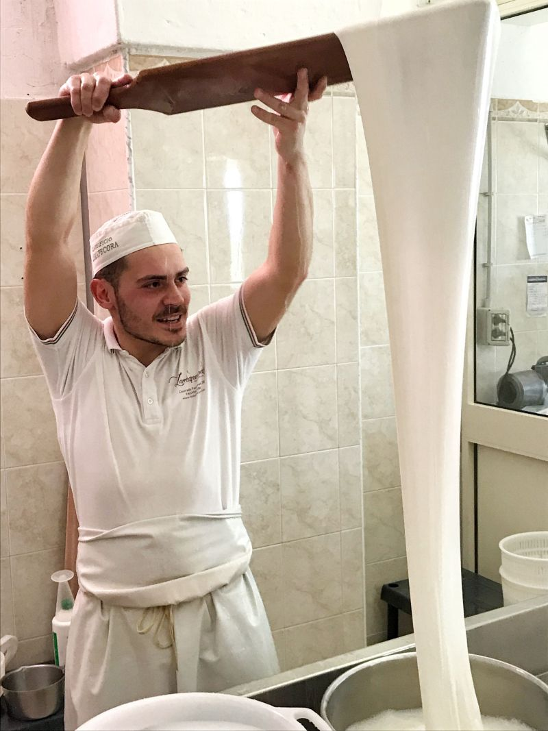 Stretching the mozzarella cheese in a cheese-making class in Puglia Southern Italy
