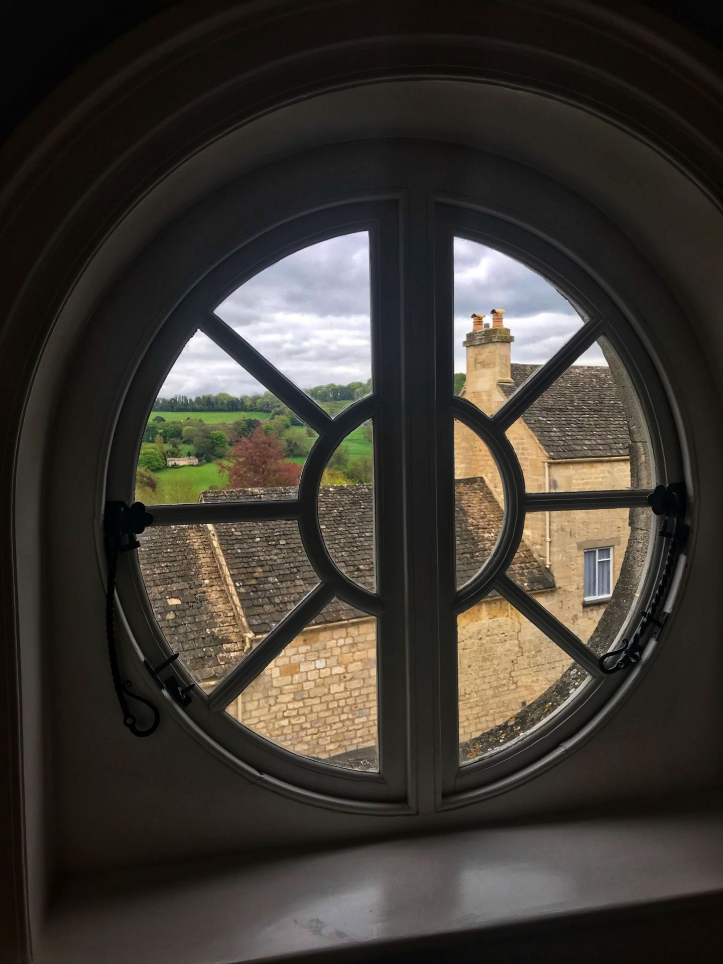 Picturesque Painswick throught the porthole window