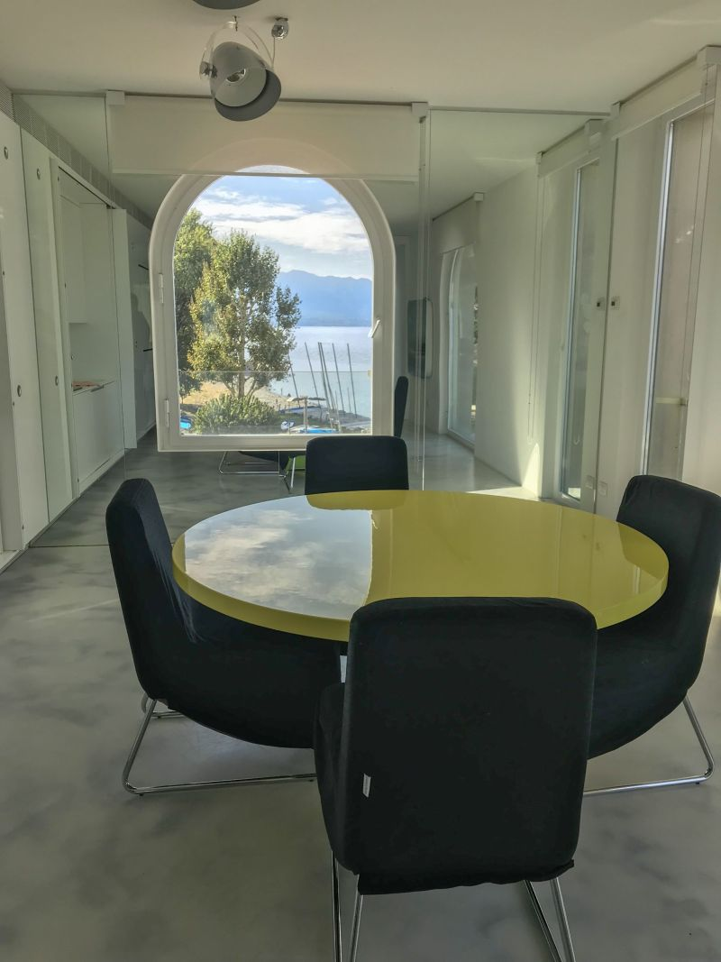 Dine with a view in this apartment at Golfo Gabella Resort Lake Maggiore