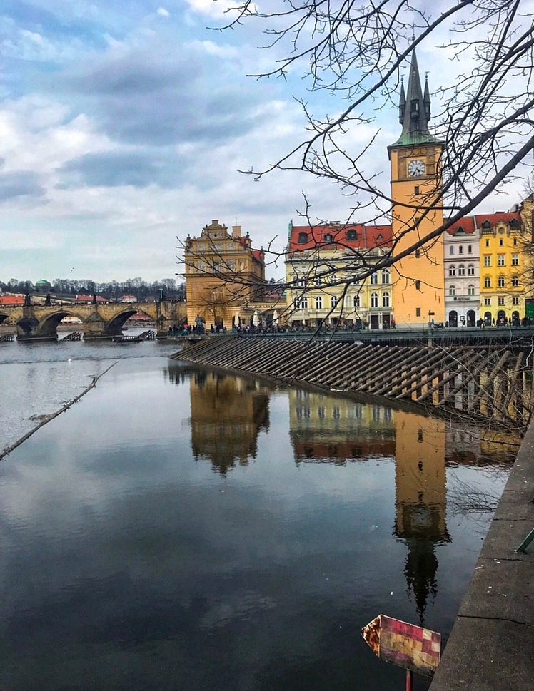 How to Spend 2 Perfect Days in Prague Itinerary - Colourful reflections across the Vltava River Prague