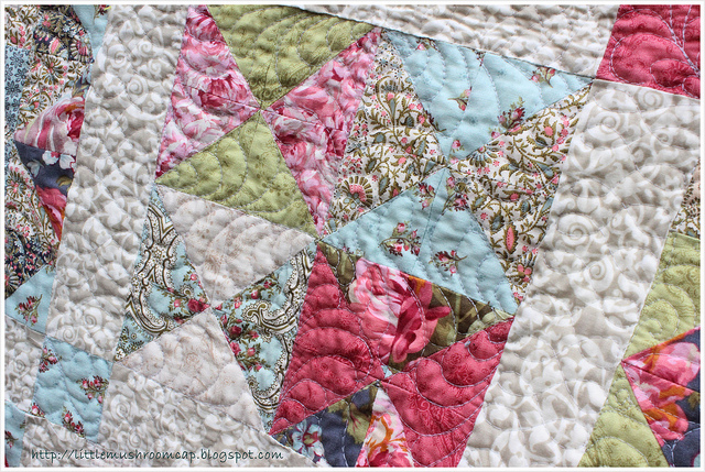 close up feather quilting in blocks