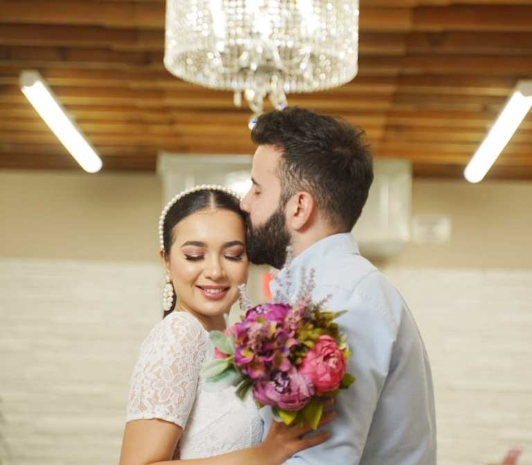 Couple under Chandelier in Las Vegas Wedding Chapel