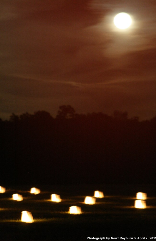 The Moon watches over the luminaries at The Hornet's Nest, April 7, 2012 Photograph by Newt Rayburn