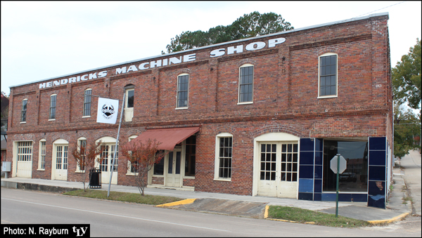 "Outside of Yalobusha Brewing Company building in Water Valley - with ""Hendricks Machine Shop"" still painted on the wall's top edge"