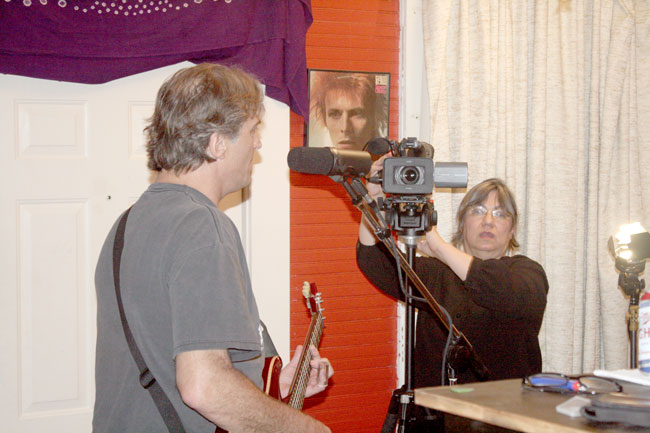 Oxford Sounds Producer Marie Antoon films George McConnell playing live in Black Wings Studio near Water Valley, Mississippi. Photograph by Newt Rayburn.