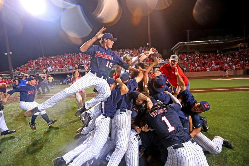 Ole Miss celebrates after winning the Super Regional in Lafayette, Louisiana on Monday night.