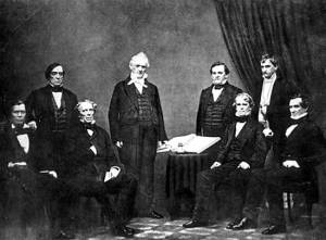 President Buchanan and his Cabinet From left to right: Jacob Thompson, Lewis Cass, John B. Floyd, James Buchanan, Howell Cobb, Isaac Toucey, Joseph Holt and Jeremiah S. Black, (c. 1859)