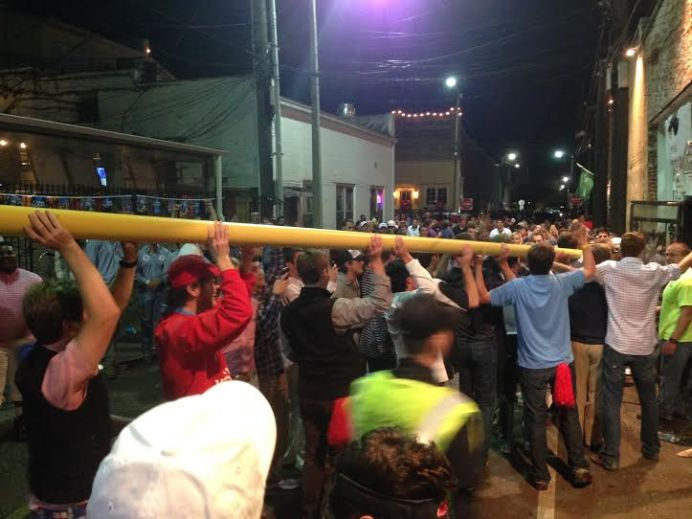 Ole Miss Students continued to parade a section of a goalpost from Vaught-Hemingway stadium for nearly two hours. Here they are in front of The Library Sports Bar at 8:45 pm. Photograph by Max McDonaldson. - See more at: http://www.thelocalvoice.net/oxford/?p=16879