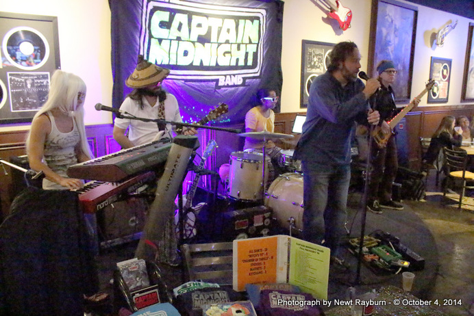 "Chris Sartin, owner of Soulshine Pizza Factory, sings ""Will The Circle Be Unbroken"" with The Captain Midnight Band in honor of Stan Sandroni, Ole Miss' radio personality who recently passed away."