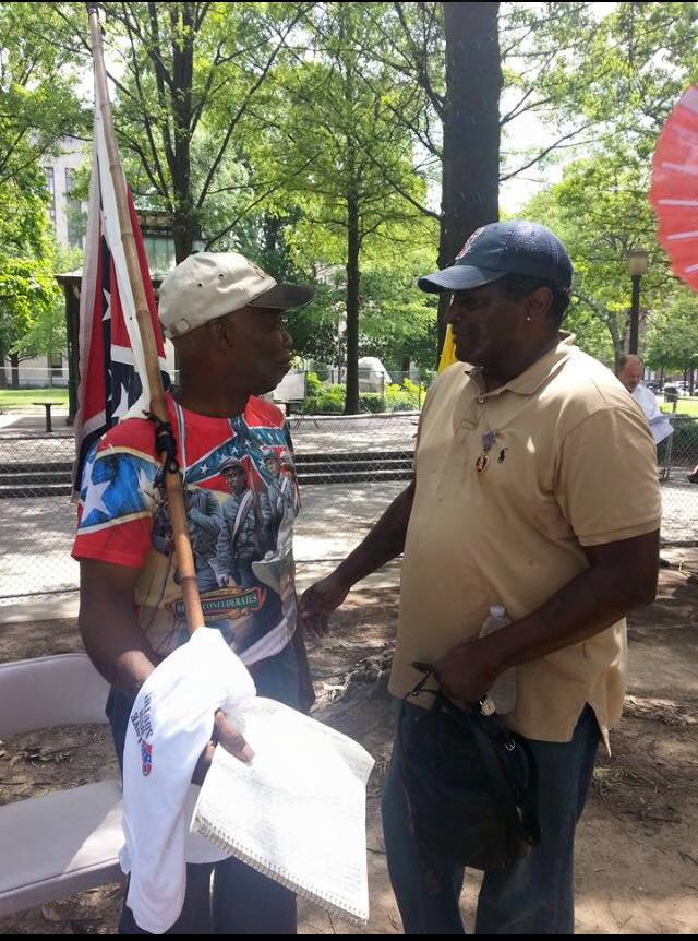 Anthony Hervey (right) and H.K. Edgerton (left) at the Birmingham, Alabama Confederate History rally July 18, 2015, just hours before his death. Hervey gave a fiery speech at the rally.