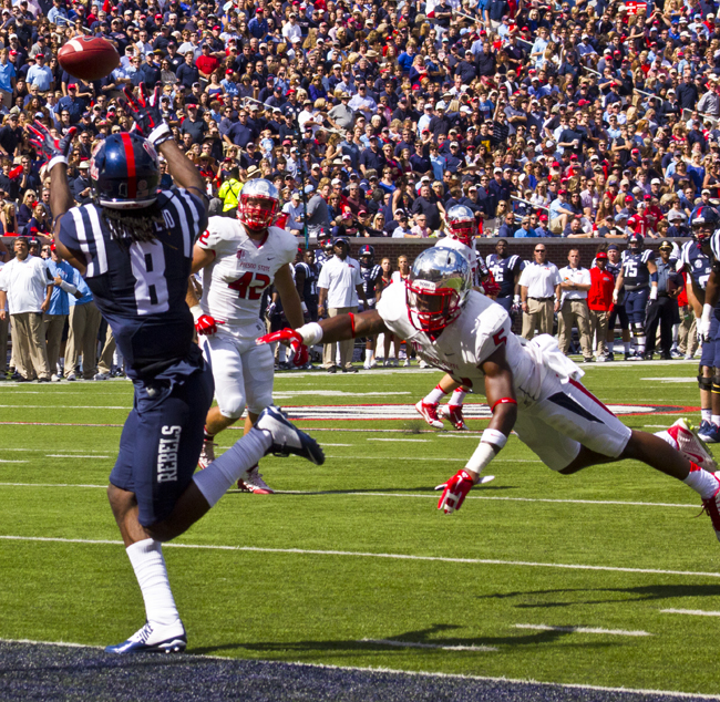 Quincy Adeboyjo scored three touchdowns for the Rebels in the first half against Fresno State. Photograph by Shelby Rayburn - The Local Voice.
