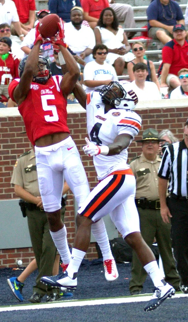 DaMarkus Lodge catches a 12 yard touchdown pass from DeVante Kinciad in the Fouth Quarter over UT Martin Defensive Back Jaquille White. Photograph by Shelby Rayburn - The Local Voice.
