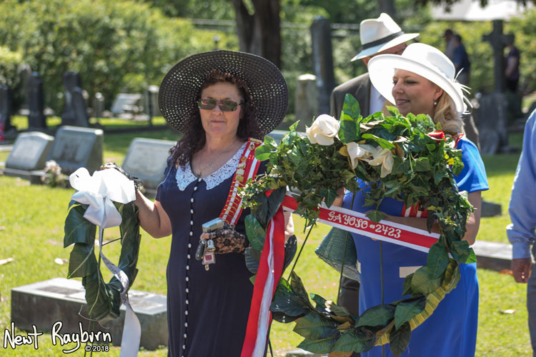 Lani Burnette Rinkel and Dore Dorris lay wreaths at the graves of Confederate soldiers. Photograph by Newt Rayburn - © May 6, 2018.