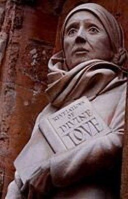 The statue of Julian of Norwich on the West Front of Norwich Cathedral, made by the sculptor David Holgate in 2014. Julian of Norwich was an anchorite who provided spiritual counsel to her community and is believed to have been the first female to write a book in English.