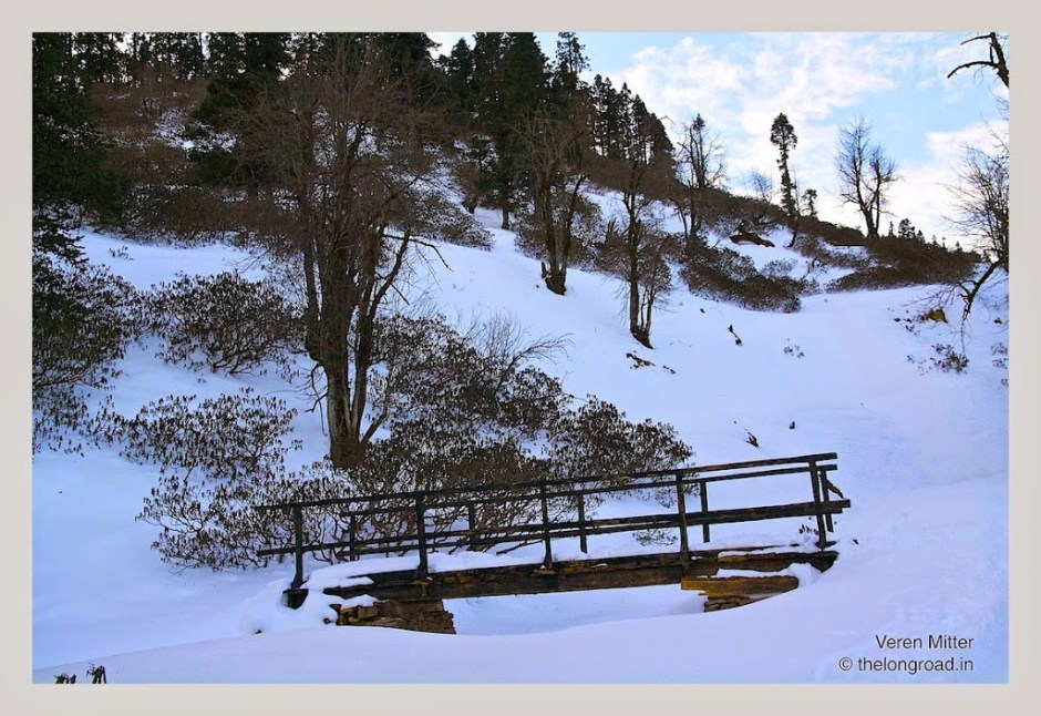 A view of foot bridge in mountains covered with snow.kedarkantha trek