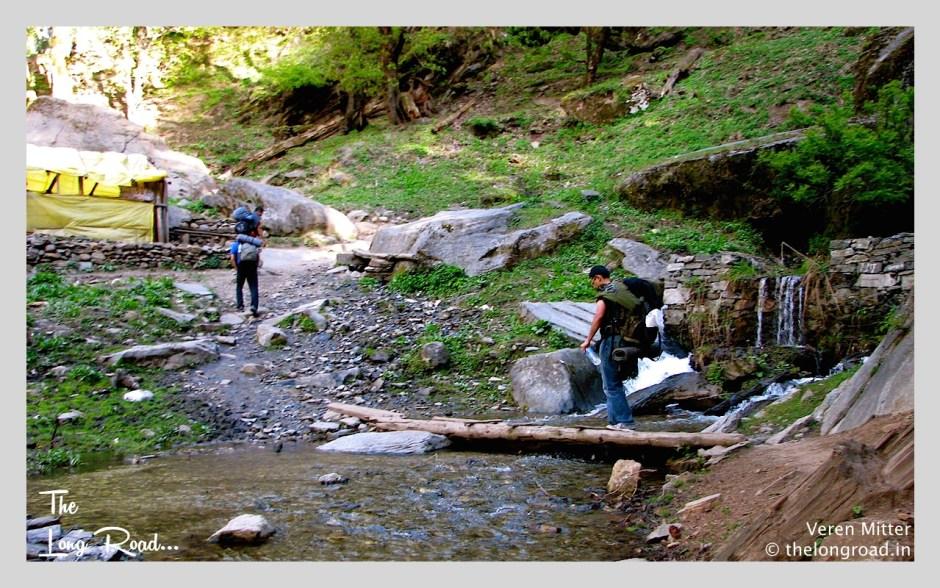 Crossing Water streams on the way to kheerganga