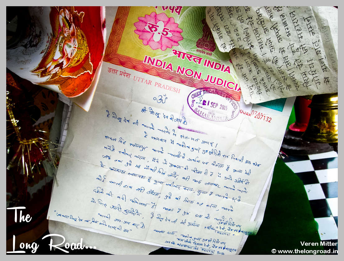 Stamp paper offered to God at a temple