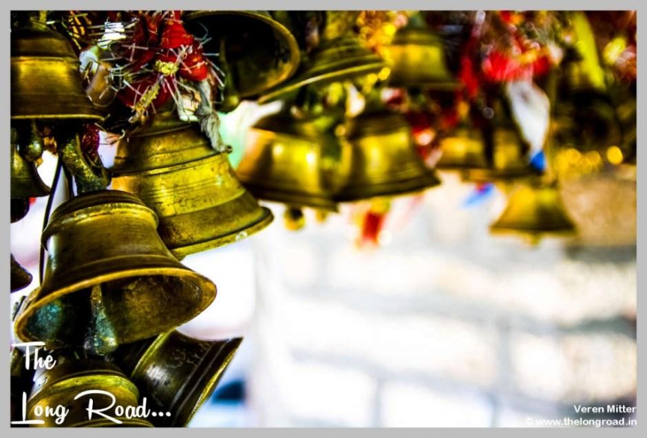 tiny brass tempe bells tied in row at Kumaon Uttarakhand Himalaya India