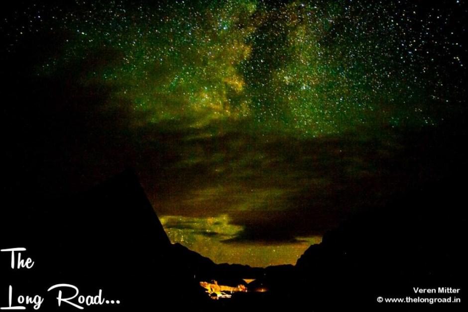 Sheshnag lake at night with celestial activity above it. Amarnath