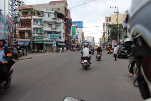 Riding on the back of a motorcycle taxi in Vietnam