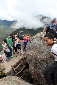 A view of the boulder atop Huayna Picchu. And in the right corner, the guy who almost fell of the rocks just to take a photo of me.