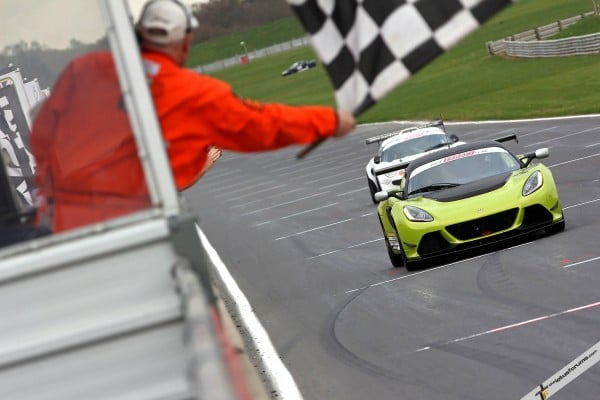Adam Balon takes the flag ahead of Adrian Hall in Lotus Cup UK