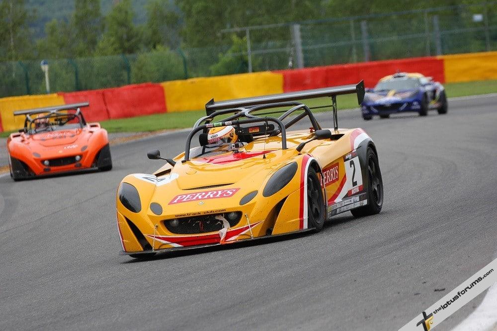 Ken Savage (2) won the Lotus Cup UK race from Marcus Jewell (orange 2-Eleven) (credit: Derek Partridge)