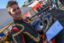 Overall champion Balogh receives congratulations from Group Lotus