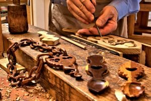 Handcarving lovespoons at The Lovespoon Workshop