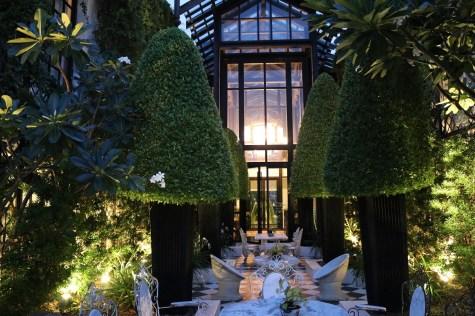 English garden at night - The Siam Hotel