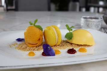 Mango cheesecake, ice-cream and macaron at Chon Thai restaurant - The Siam Hotel