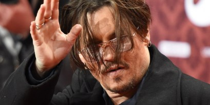 "US actor Johnny Depp waves on the red carpet for the film ""Mortdecai"" in Berlin January 18, 2015. The film starts in German cinemas on January 22, 2015. AFP PHOTO / TOBIAS SCHWARZ (Photo credit should read TOBIAS SCHWARZ/AFP/Getty Images)"
