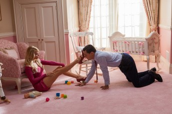 Left to right: Margot Robbie is Naomi Lapaglia and Leonardo DiCaprio is Jordan Belfort in THE WOLF OF WALL STREET, from Paramount Pictures and Red Granite Pictures. TWOWS-03426R